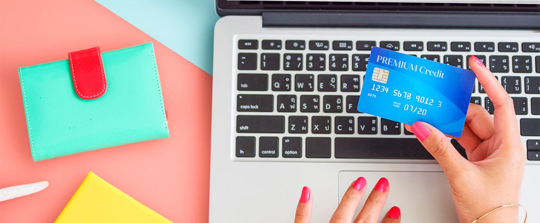 Woman securely entering credit card on online website