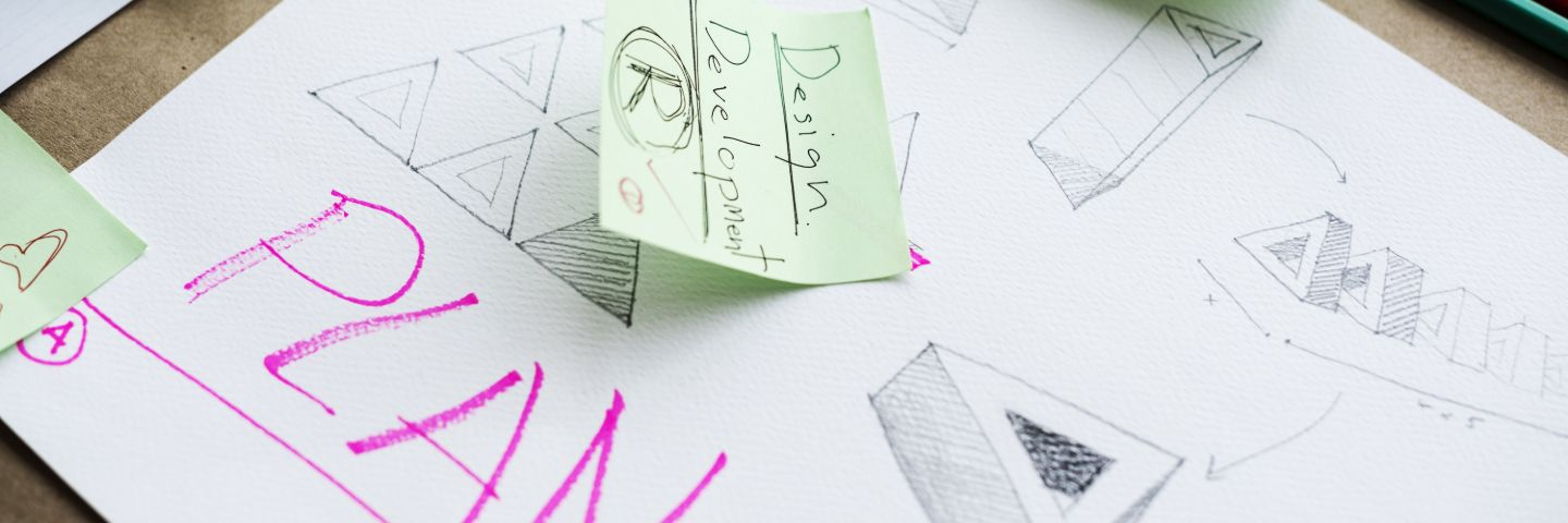 Graphic Design sketches of logos on desk