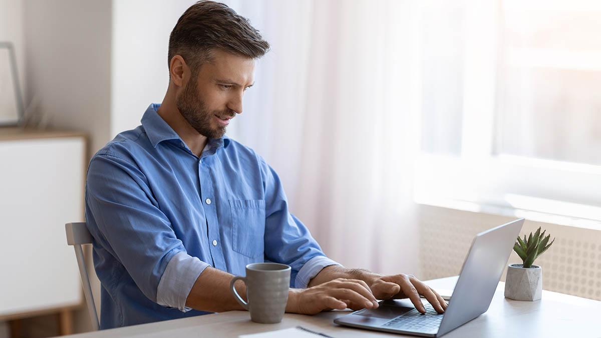 Man updating his business website