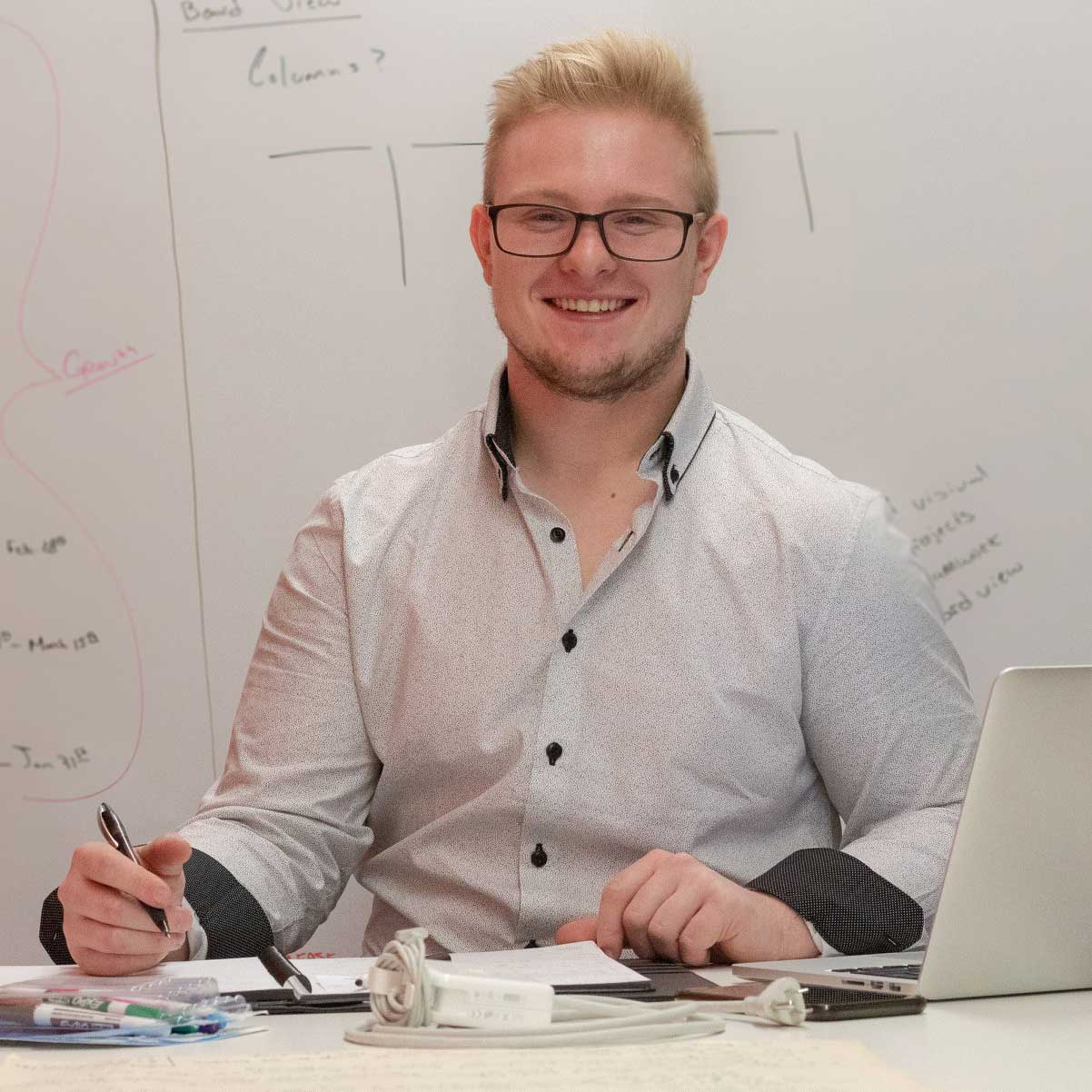 Project Manager, Cody Butler creating wireframes on whiteboard