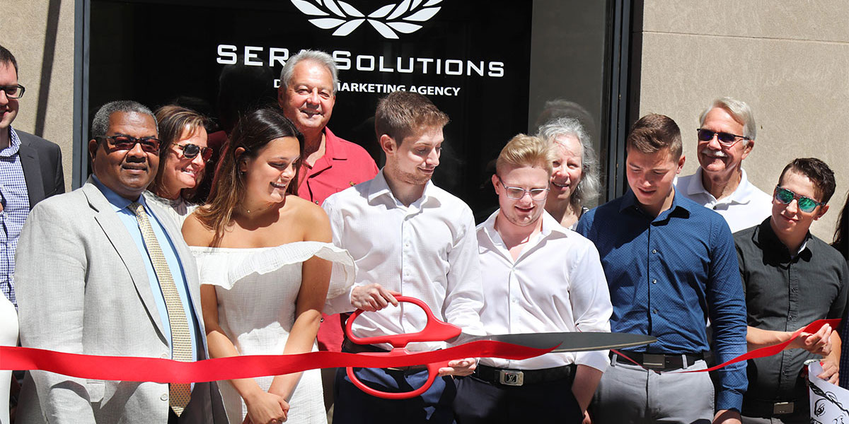 Sera Group team at official office ribbon cutting