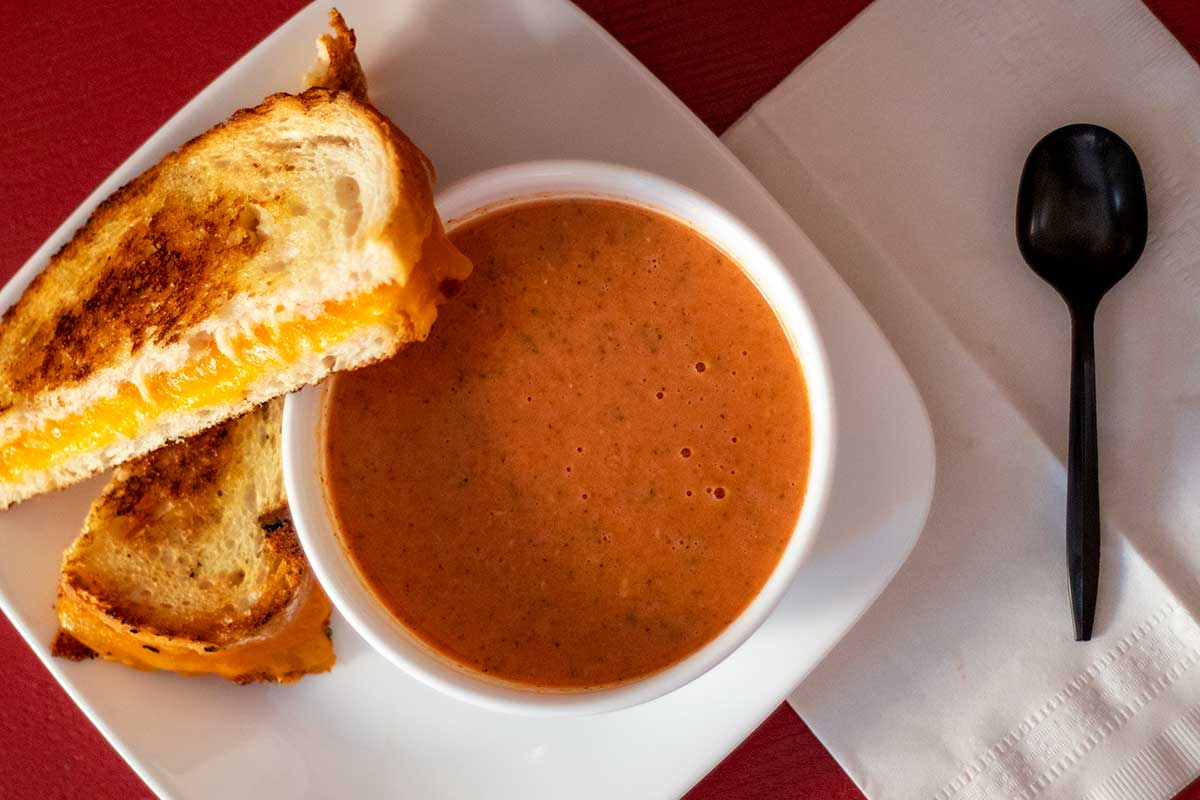 Food photography gourmet grilled cheese with homemade tomato basil soup