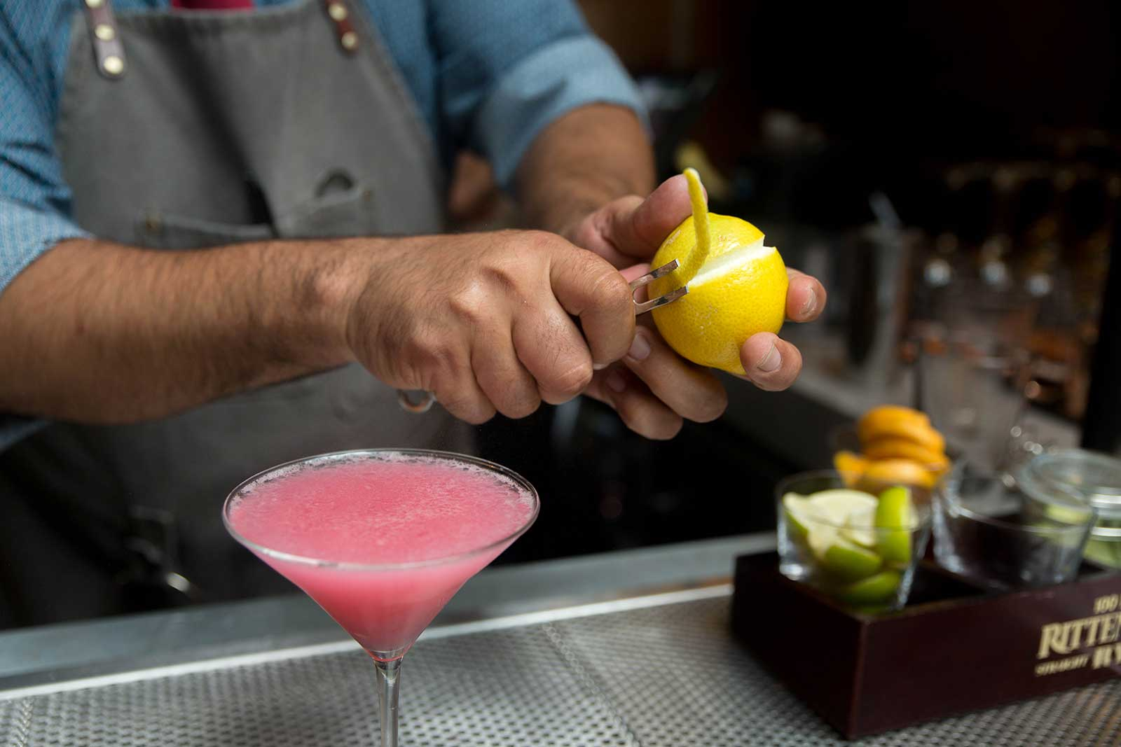 Bartender mixing a pink cocktail